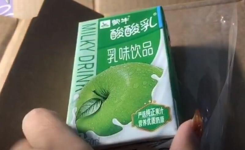 女子花万元网购苹果手机 拆开包裹后竟是苹果酸酸乳